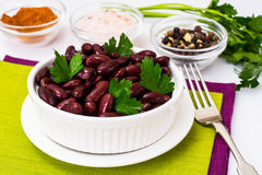 Beans, spices and curry in white salad bowl Stock Images