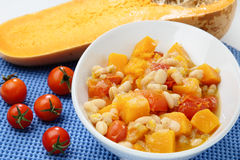 Beans stew with cherry tomato and pumpkin. In white bowl Royalty Free Stock Images