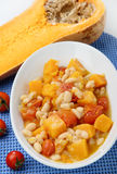 Beans stew with cherry tomato and pumpkin. In white bowl Stock Photography