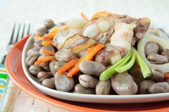 Beans stewed with pork ribs, carrots and onions Royalty Free Stock Photos