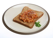 Beans on Toast. A simple snack of Beans on Toast isolated stock photo
