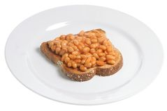 Beans on Toast. Baked beans in tomato sauce on a slice of wholemeal toast Royalty Free Stock Photography