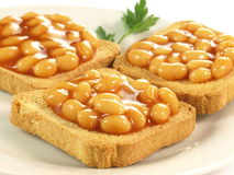 Beans on toast, closeup Stock Photos