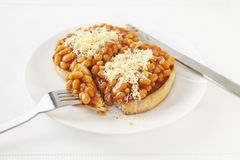 Beans on Toast with Grated Cheddar Cheese Stock Images