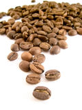 Beans of toasted coffee. On a white background royalty free stock photos