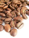 Beans of toasted coffee. On a white background royalty free stock image