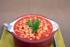 Beans on tomato Stock Photo