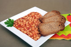Beans on tomato Royalty Free Stock Image