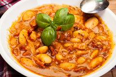 Beans with tomato sauce, bacon and sausage Stock Photography