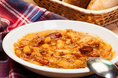 Beans with tomato sauce, bacon and sausage Royalty Free Stock Photography