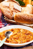 Beans with tomato sauce, bacon and sausage Stock Photo