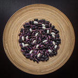 Beans. Two kinds of beans in the wooden plate Stock Images