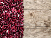 Beans on wooden background Royalty Free Stock Image