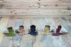 Beans on wooden boards Royalty Free Stock Photography