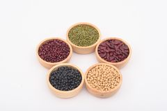 The beans are in a wooden bowl. On a white background Stock Images