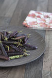 Beans on a wooden plate Royalty Free Stock Photography