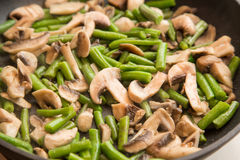 Beans with wushrooms in a pan Stock Photo