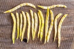 Beans yellow dry phaseolus vulgaris on a wooden table stock image