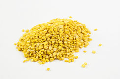 Beans, yellow on a white background and chopsticks. Royalty Free Stock Photo