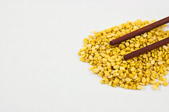 Beans, yellow on a white background and chopsticks. Stock Photos