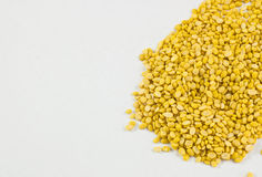 Beans, yellow on a white background and chopsticks. Royalty Free Stock Photography