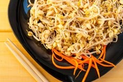 Beansprouts salad on black plate, close-up Stock Photos