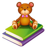 A bear above the pile of books Royalty Free Stock Photos