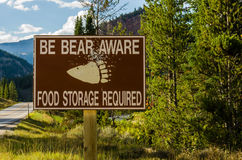 Bear Aware sign in remote area. Warning sign stock images