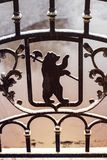 Bear with ax - Yaroslavl arms, Russia. Metal forged fence. Above the river Stock Images