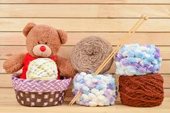 Bear in Basket with Knitting yarn balls. Bear in a basket with Knitting yarn balls and needles Stock Photography