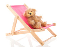 Bear in beach chair isolated over white background. Stuffed hand made bear in beach chair isolated over white background Stock Images