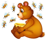 Bear and bees Royalty Free Stock Image