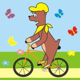Bear and bicycle. Teddy Bear riding a bike. Butterflies flying around Stock Image