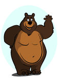 Bear. Big brown bear smiles and friendly waves a paw Stock Photos