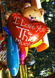 Teddy Bear with big red heart and  dolphin balloons Stock Photo