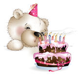 Bear blows out candles on the cake Royalty Free Stock Photography