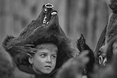 The bear boy. Unidentified bear dressed boy portrait on Traditional Bear Dance parade in Comanesti, Romania. Black and white fine art photo Stock Image