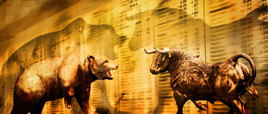Bear and bull stock market. The Wall Street bull and a bear over a golden hued stock market generation of numbers.  Concept for financial gains or losses