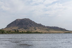 Bear Butte. A butte with a foreground lake stock photo