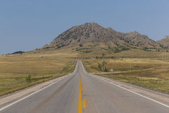 Bear Butte Highway. A highway leading to a butte in South Dakota royalty free stock image
