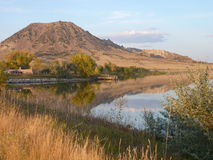 Bear Butte and Lake at Sunset Royalty Free Stock Image