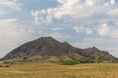 Bear Butte. A scenic butte with foreground grass stock photo
