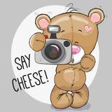 Bear with a camera. Cute cartoon Teddy Bear with a camera on a gray background Royalty Free Stock Photos