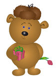 Bear in a cap gives a flower Royalty Free Stock Photography