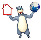 Bear cartoon character with earth and home sign Royalty Free Stock Images