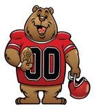 Bear cartoon football mascot Royalty Free Stock Image
