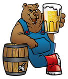Bear cartoon lean on the barrel and presenting the beer Royalty Free Stock Image