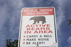 Bear caution sign for bear country wildlife and forest areas royalty free stock photo