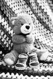 Bear with child shoes Royalty Free Stock Images