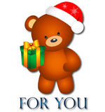 Bear with Christmas present Royalty Free Stock Photos
